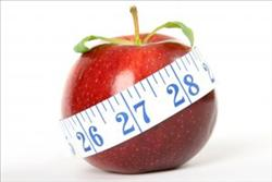 red apple wrapped around by a measuring tape