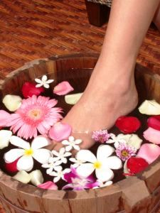A foot soaking in a flower bath
